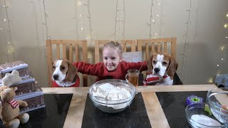 Cute Dogs Help Little Girl Bake Dog Cookies for Christmas